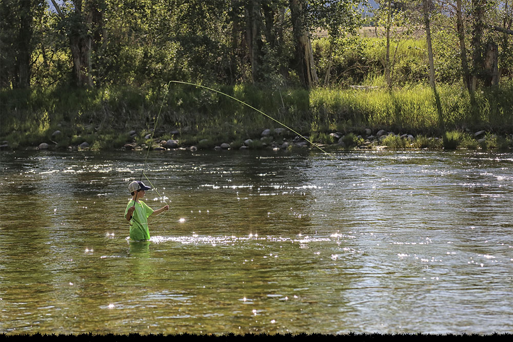 Fishing in the Bitterroot River at Anglers Roost Campground in Montana