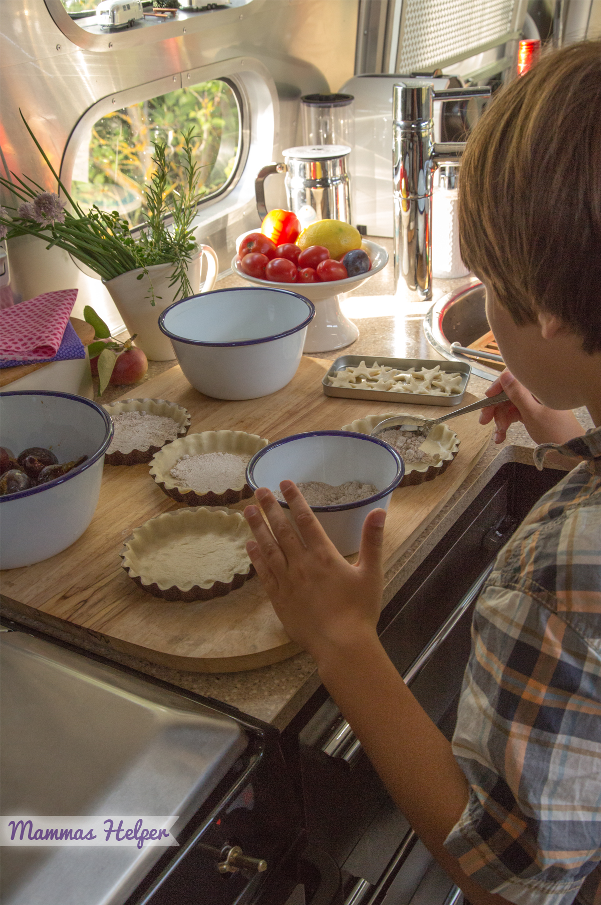 B helping me in the Airstream kitchen with plum tarts