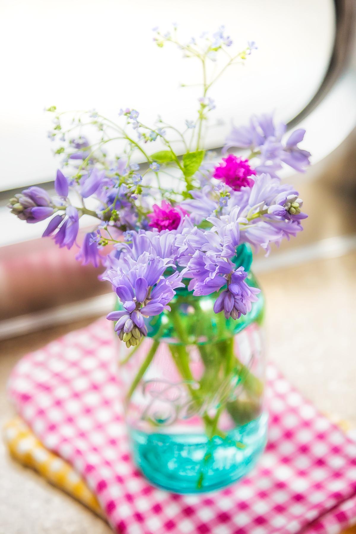 Spring Flowers in Blue Ball Mason Jar via J5MM.com #Airstream